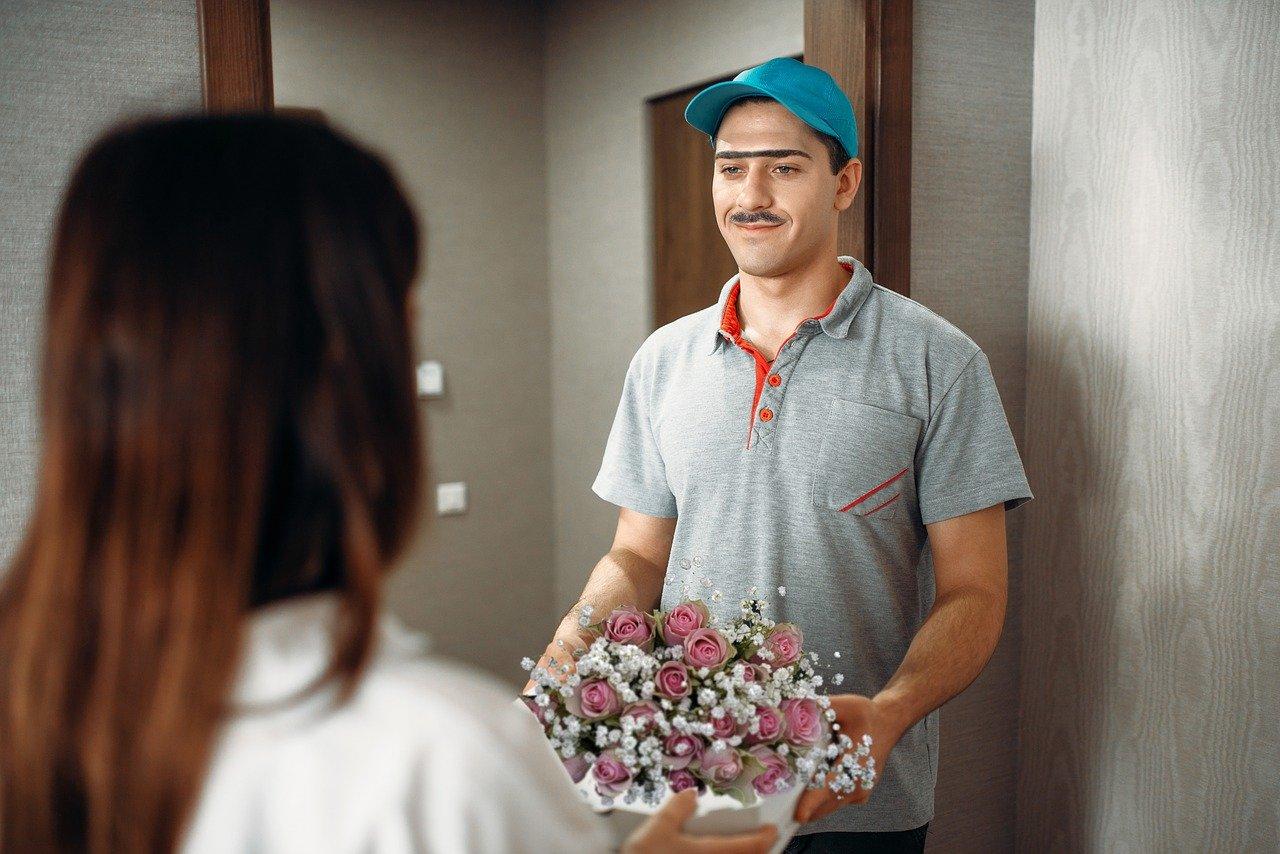 delivery man get flowers delivered